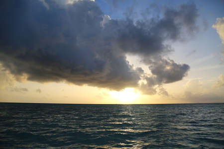 sunset over the indian ocean seen from an atoll in the maldives