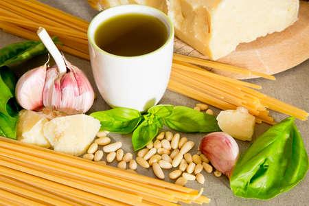 Natural ingredients to make Genoese pesto.Typical Italian recipe with parmesan, basil, oil, garlic, pasta and pine nuts