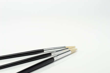 Image of three fine stroke brushes for watercolors 免版税图像