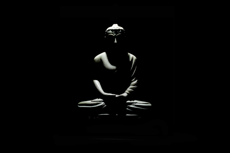 Buddha statue isolated on black background