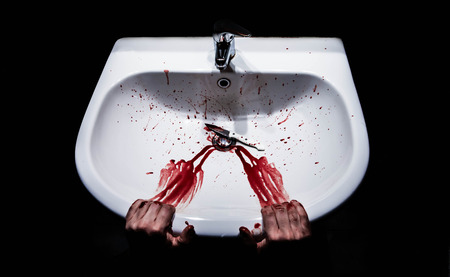 Suicide concept - bleeding hands and knife in a sink photo