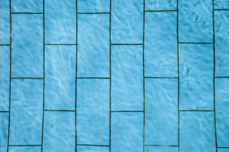 Texture of blue swimming pool tiles  photo