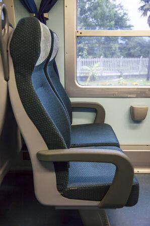 intercity: Blue and gray seats of an italian train  Stock Photo