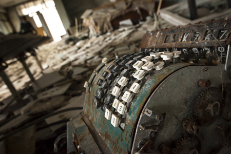 alienation: Old rusty cash register on the floor of an abandoned store in Pripyat - Chernobyl nuclear power plant zone of alienation