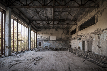 alienation: Abandoned basketball court in Pripyat - Chernobyl nuclear power plant zone of alienation
