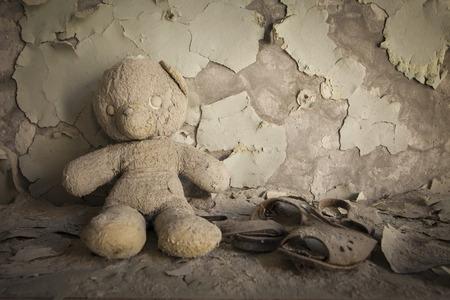 alienation: Old white teddy bear in an abandoned kindergarten in Pripyat - Chernobyl nuclear power plant zone of alienation