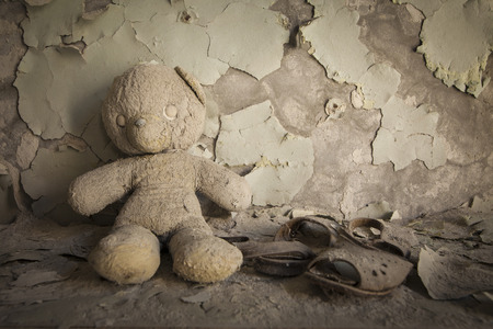 Old white teddy bear in an abandoned kindergarten in Pripyat - Chernobyl nuclear power plant zone of alienation