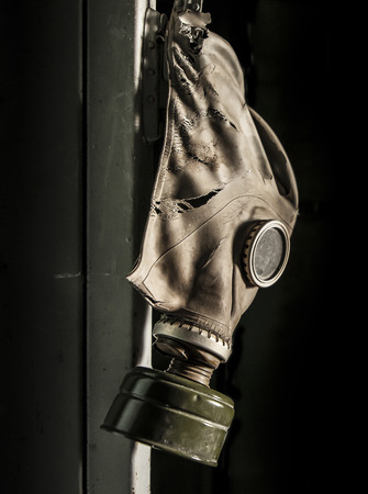 alienation: Gas mask hanging on a locker in an abandoned factory in Pripyat - Chernobyl nuclear power plant zone of alienation