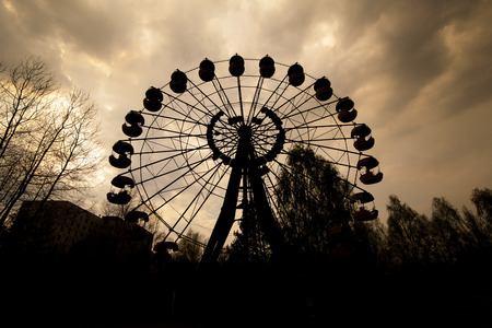 alienation: Silhouette of the abandoned Ferris wheel in the amusement park in Pripyat. Chernobyl nuclear power plant zone of alienation