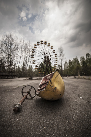 amusement: The abandoned Ferris wheel in the amusement park in Pripyat. Chernobyl nuclear power plant zone of alienation Stock Photo