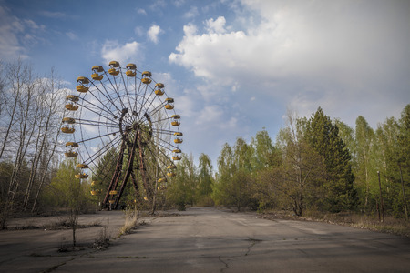 The abandoned Ferris wheel in the amusement park in Pripyat. Chernobyl nuclear power plant zone of alienation Stock Photo