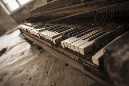 pripyat: Close-up of an old piano keyboard in an abandoned auditorium in Pripyat. Chernobyl nuclear power plant zone of alienation