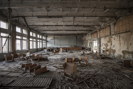 accident dead: Symmetrical view of an abandoned classroom in a school of Pripyat. Chernobyl nuclear power plant zone of alienation
