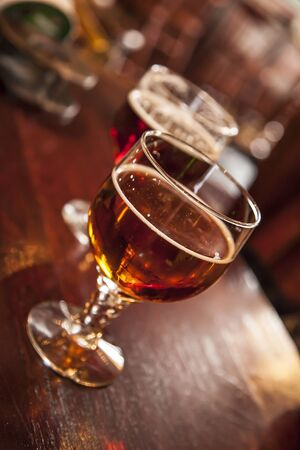 draught: Two glasses of draught beer, a red and a amber beer