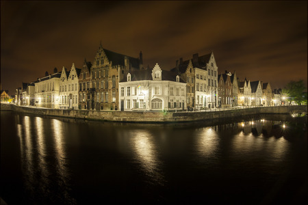 nocturnal: Romantic nocturnal view of a canal in Bruges. Buildings are reflected in the water