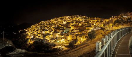 nocturnal: Nocturnal panoramic view of Prizzi, a typical village located in the middle of the Sicily Stock Photo