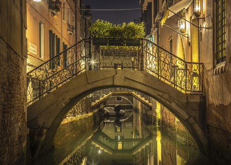 Romantic view of a nocturnal canal in Venice