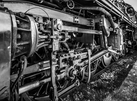 Wheels of an old steam locomotive, black and white image Banco de Imagens