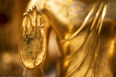 Hand of a golden Monday Buddha statue at Doi Suthep Temple (Chiang Mai - Thailand)