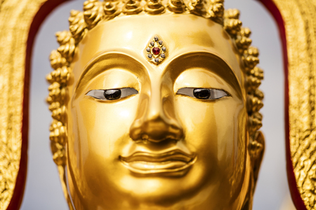 Face of a golden Buddha statue at Doi Suthep Temple (Chiang Mai - Thailand)