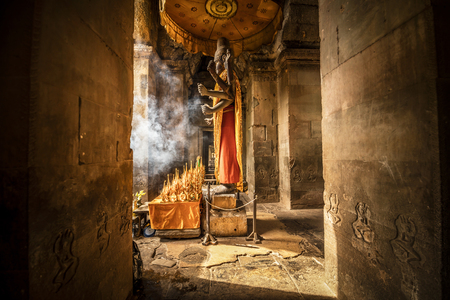 Ancient Buddha statue in Angkor Wat temple, Siem Reap, Cambodia