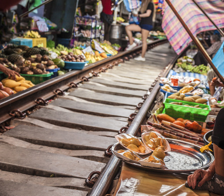 Maeklong Railway Market, a local market commonly called Siang Tai (life-risking) Market. It is considered one of amazing-Thailand attractions. Spreading over a 100-metre length, the market is located by the railway near Mae Klong Railway Station