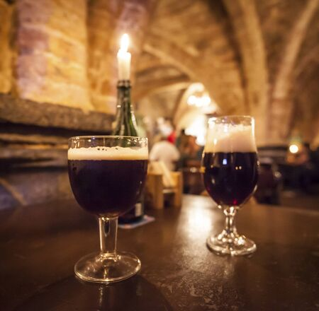 Beer glasses and a romantic candle in a typical Belgian pub