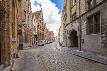 Street in Bruges (Belgium) with old and typical houses Standard-Bild