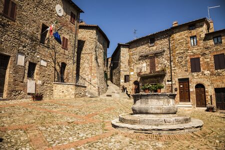 A typical small square of Castiglione d'Orcia, an ancient village in Tuscany, Italy