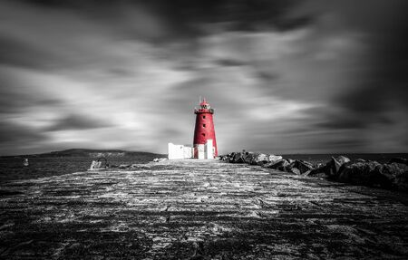 Poolbeg Lighthouse in Dublin with it's red colour standing out