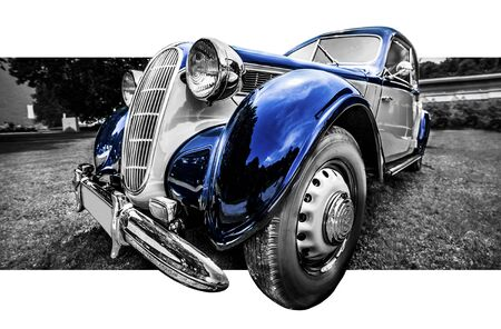 Old classic blue and grey car in a black and white image