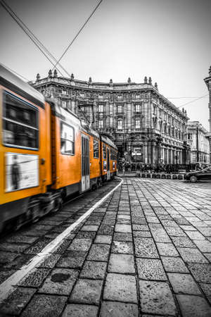 Milan, Italy, June 11, 2017Milan street panorama with Milan trams, pedestrians and cars on a sunny day
