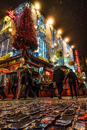 Dublin, Ireland, November 7, 2019: Christmas decoration in Temple Bar district, Dublin in a rainy night Editorial