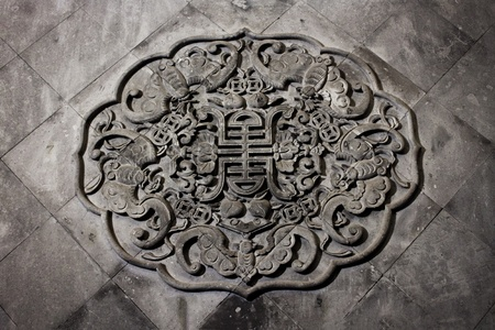 stone carving: Chinese prosperity motif on stone wall