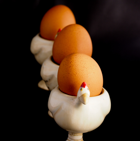 egg cup: Eggs on the egg cup Stock Photo