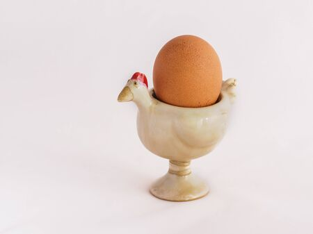 egg cup: An egg on the egg cup Stock Photo
