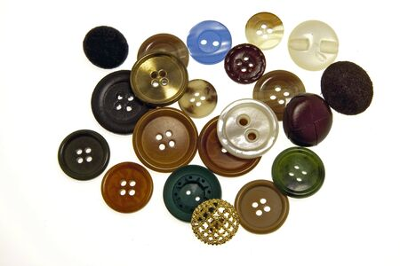 Assorted buttons of various colors on white bottom