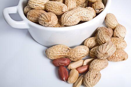 Roasted peanuts on a white bachground photo