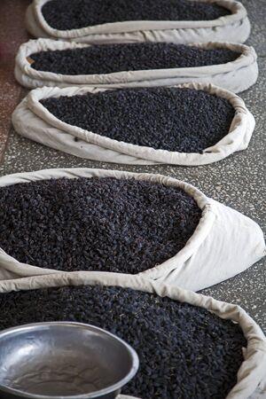 Black raisins in the market photo