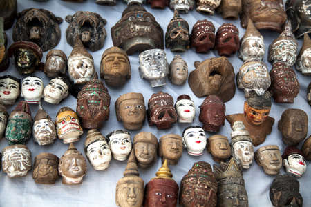 Myanmar, the market, heads of ancient puppets Stock Photo - 17831867