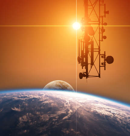 Communication tower is orbiting around planet Earth Stock Photo