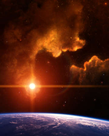 Rising Sun on Planet Earth with orange Nebula Stock Photo - 13063825