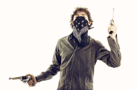 Bandit with mask and Guns Stock Photo - 17657422