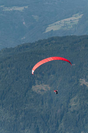 Paraglider above Austrian Alps