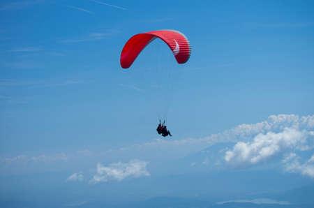 parasailing: Paraglider over Austrian Alps with Krawanken Range on near Mount Gerlitzen  Ossiach, Carinthia - Austria  Stock Photo