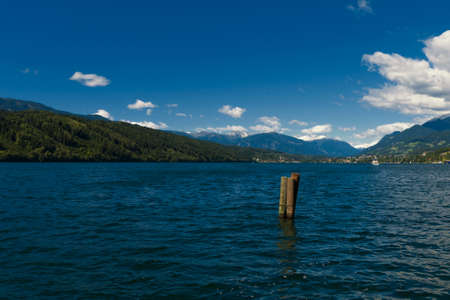 Austrian Lake of Millstat with Alps and puffy Clouds Stock Photo