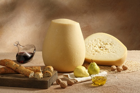 decanter: typical italian cheese with pears,walnut, wine, olives bread and extra virgin olive oil