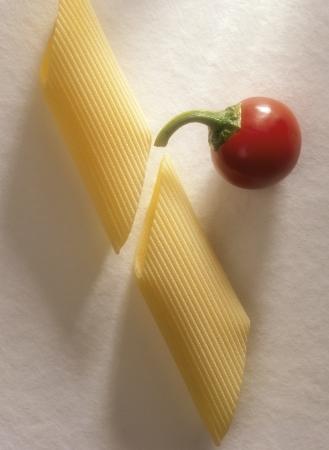 semolina pasta: macaroni wheat with red pepper, Short semolina Pasta shapes
