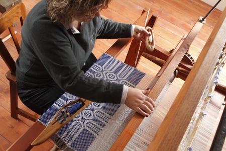 weaving: a woman work on vinage hand loom