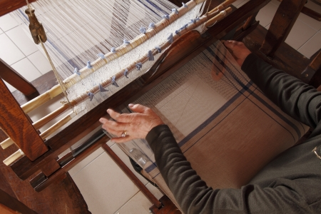hand woven: a woman work on a hand loom